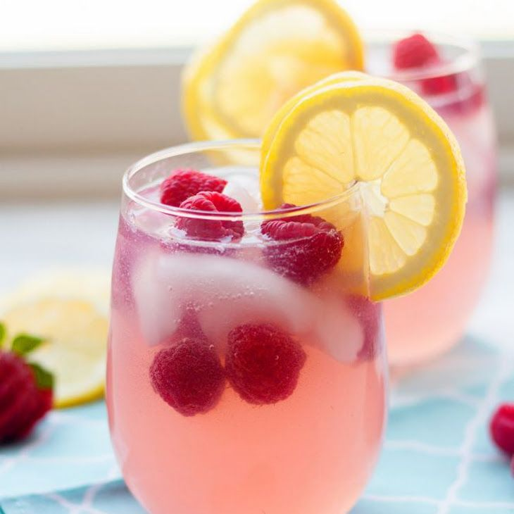 Raspberry Lemonade Sangria Recipe Beverages with white wine, vodka, lemonade concentrate, sprite, fresh raspberries