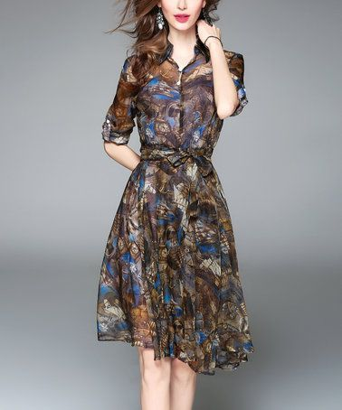 Brown Abstract Clocks Shirt Dress  This is so cute, adorable and trendy.  It is easy to dress this up or down for an evening on the town or a casual day out running errands.  This is fashion at its best for 2017 and I can appreciate how cute this is and that it can be worn all year around.    This can be paired with many different fashion accessories.