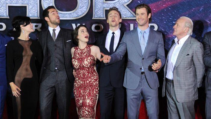 """Thor: The Dark World"" cast Jaimie Alexander, Zachary Levi, Kat Dennings, Tom Hiddleston, Chris Hemsworth and Anthony Hopkins greet the crowd."