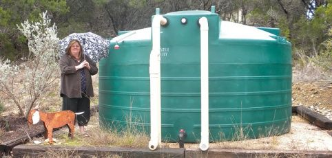 Drought coming?   Save rainwater!  Nancy Poage-Nixon with her 5,000-gallon rainwater storage tank