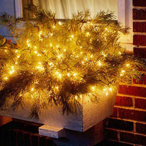Gartenbeleuchtung zu Weihnachten zweige ziegel fassade