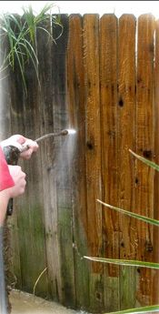 Cleaning and staining a fence