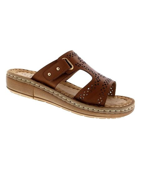 Slide into comfortable style with this relaxed sandal complete with a breathable design and delicate cutouts.