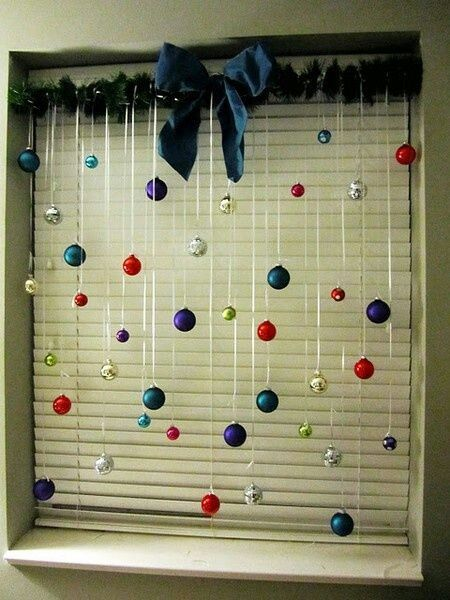 Decorate your windows with some Christmas tree bulbs.