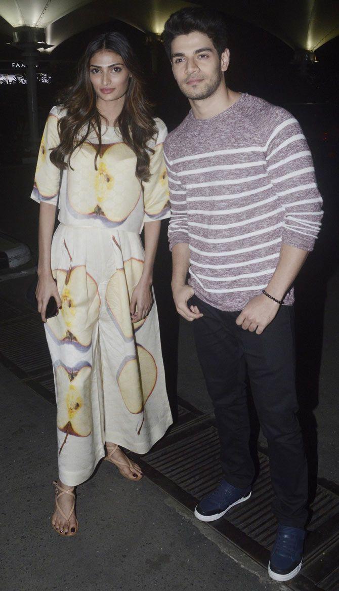 Sooraj Pancholi and Athiya Shetty at the Mumbai airport. #Bollywood #Fashion #Style #Beauty #Handsome