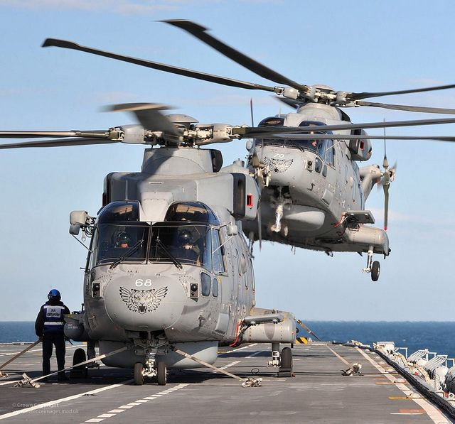 Merlin Helicopters with 814 Naval Air Squadron on HMS Illustrious during Exercise Joint Warrior near Scotland by Defence Images, via Flickr  814 Naval Air Squadron – better known throughout the Navy as the Flying Tigers (hence their striking badge) – flies from ships and air bases around the world shielding the Fleet from submarines.