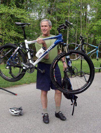 G.W. Bush rides a bike!