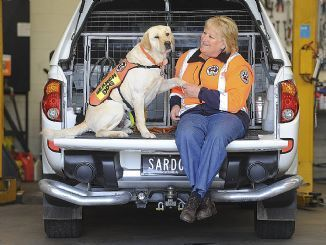 Julie Cowan with her search and rescue dog, Gus.