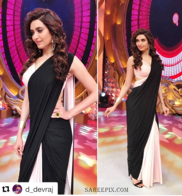 Bollywood actress Karishma Tanna latest photo in Shivan and Narresh drape saree. She looks awesome in black and white combination saree with sleeveless bik