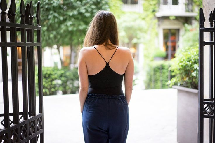 Caterina is wearing the black Wellicious catsuit and navy blue linen trousers.