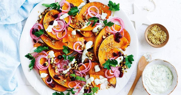 Dried cranberries add a touch of sweetness to this festive pumpkin and pistachio side salad.