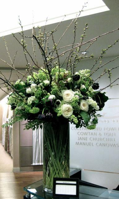 tall glass cylinder vase filled with greenery white roses and branches | Polux Fleuriste