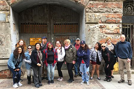 Travelers on Mercer County Community College's (MCCC's) Study Tour to Poland from May 14 to 22, 2016, in  the doorway of one of the last remaining buildings of the Warsaw Ghetto.