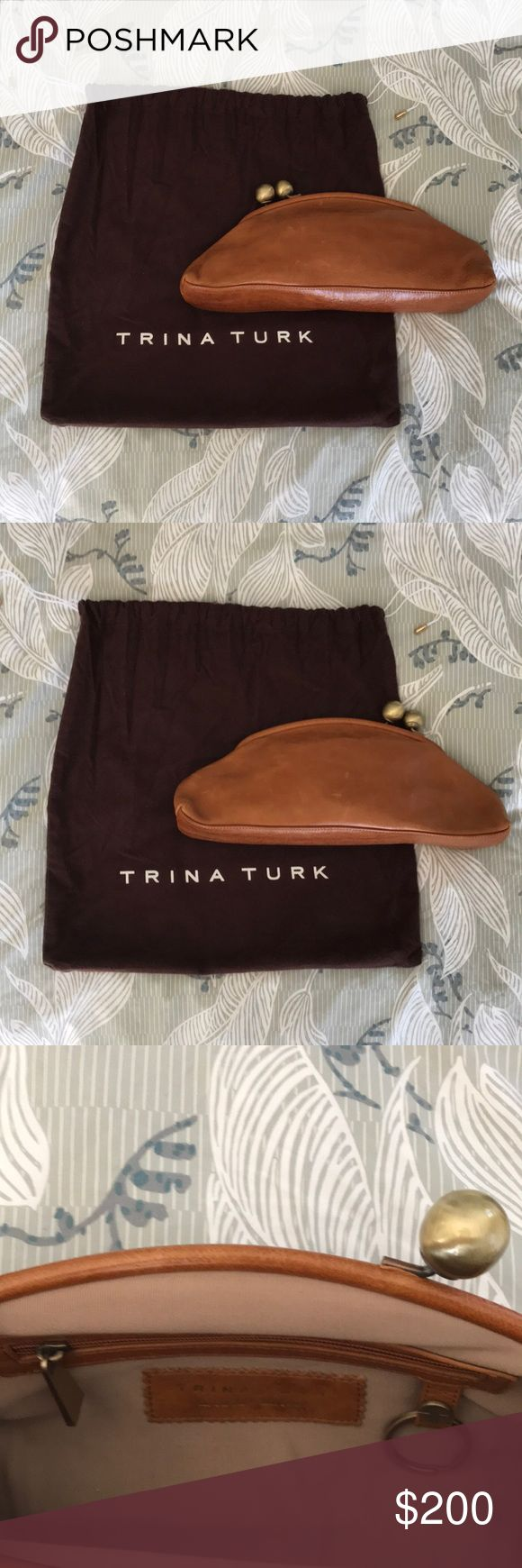 Trina Turk Leather Clutch NWOT Gorgeous Leather Clutch with interior zip pocket, key holder, and handheld mirror with pocket. Slight wear on closure is how the bag came. NWOT Trina Turk Bags Clutches & Wristlets