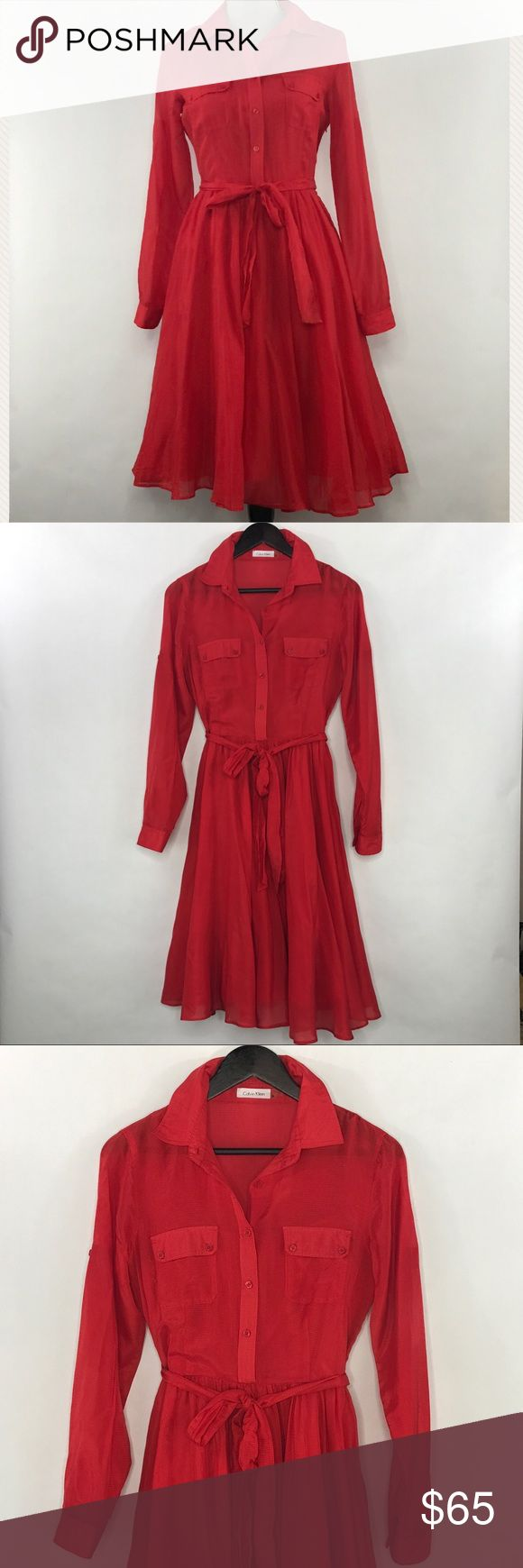 Calvin Klein dress Stunning and fashionable red dress! Button front bodice, has side zipper, button cuff and tab-up sleeves. Dress is semi-sheer but has a removable slip. Calvin Klein Dresses