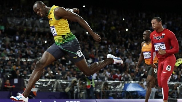 Jamaica's Usain Bolt crosses the finish line to win gold in the men's 100-meter final. Bolt broke his own Olympic record from the 2008 Beijing Games by finishing at 9.63 seconds.