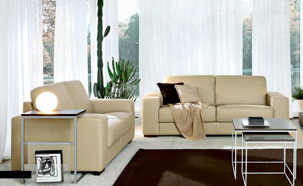 Modern Western Living Room with Beige Leather Sofa and Brown Rugs