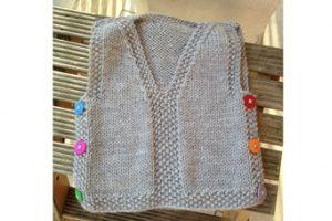 Schema per un caldo gilet di lana da neonato