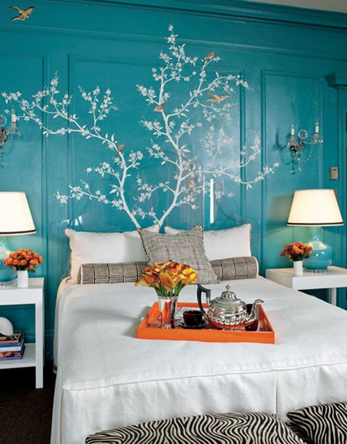 Love the color of this wall and the mural/decal. Also love the pops of orange against the blue/teal.