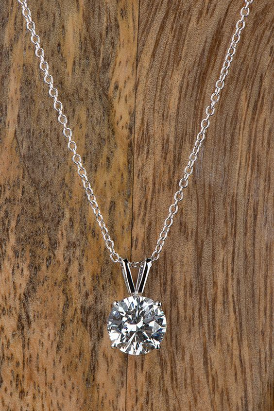 Classic style meets elegant sparkle with a timeless diamond pendant necklace from Forevermark. This…