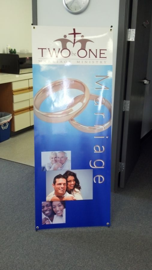 "This banner is fabricated on a specialty ""no-curl"" banner that is almost like a thick paper. We then laminated it, put grommets in the four corners and then mounted to a specialty X-stand from Orbus. Very nice eye-catching piece!"