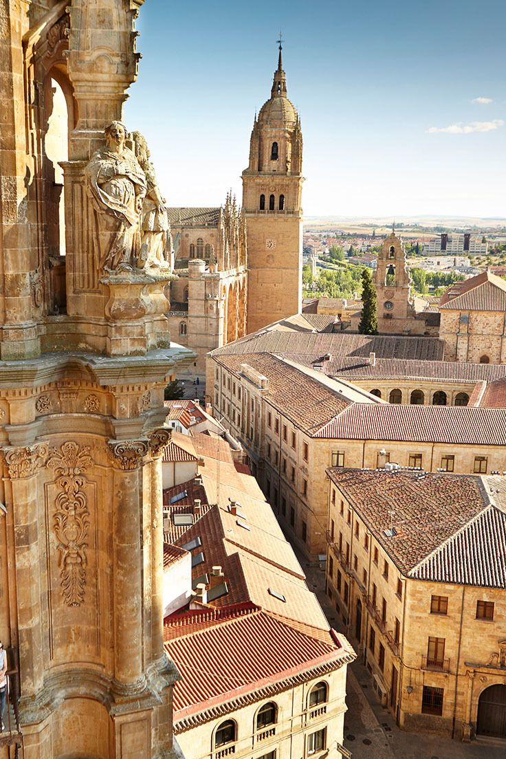 The city of Salamanca in northwest Spain, known as the 'Oxford of Spain' and home to the country's oldest and most prestigious university. This view looks towards the Old Cathedral from one of the twin towers of the Clerecia Church // photo by Matt Munro #salamanca #spain
