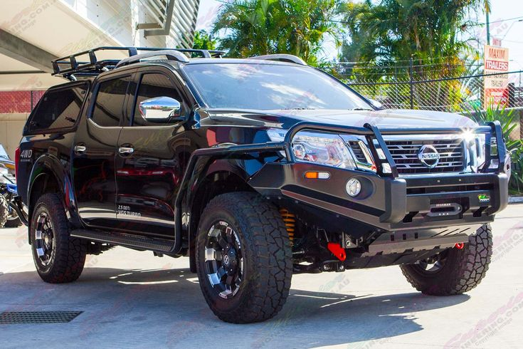 Front right view of a Black NP300 Nissan Navara dual cab fitted out with a complete range of Ironman 4x4 accessories.