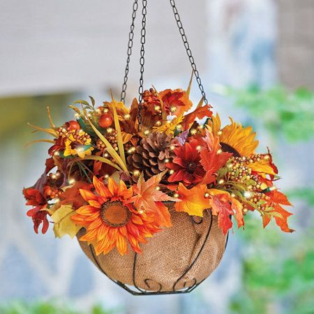 """Hang the 20"""" Pre-Lit Sunflower Fall Hanging Basket on your porch or in a window to cast a warm glow throughout your neighborhood."""