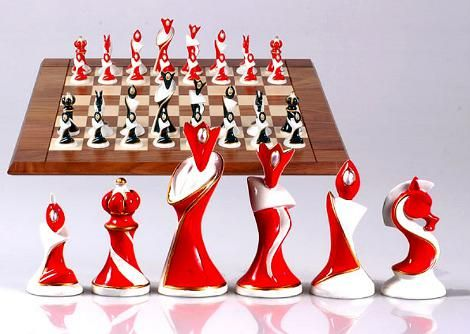 Art Deco Chess Set - Porcelain-like, unique Art-Deco styled chessmen bring vivacious cheer and lighthearted holiday accents.  Distinctive pieces shine in bright red and dark green with faux pearl inlay