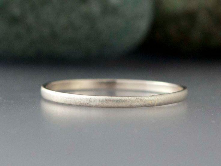14k White Gold Thin Wedding Band - 1.3mm Solid gold half round ring. $112.00, via Etsy.