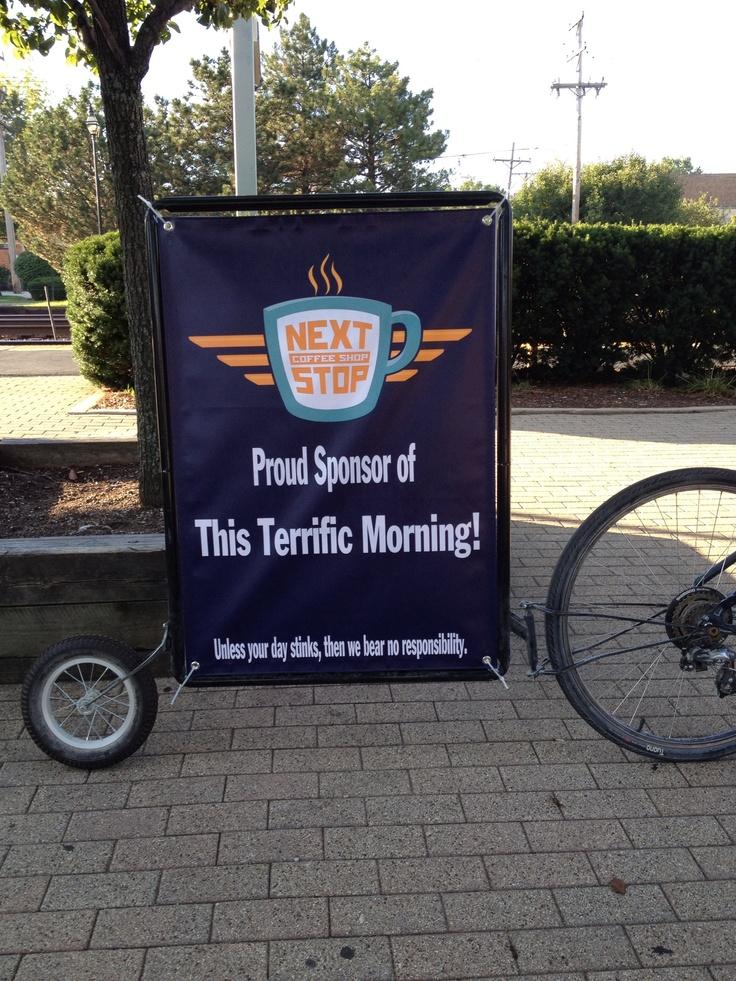 Bike billboard advertising for Next Stop Coffee Shop.