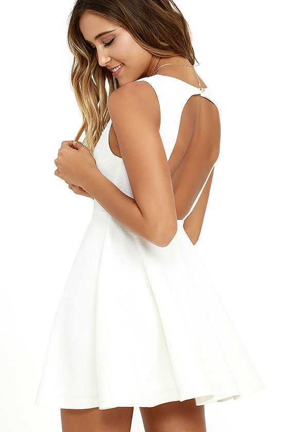 The Gal About Town White Skater Dress is perfect for the busy girl who gets invited to everything! Textured stretch knit forms a sleeveless bodice with princess seams above a flirty skater skirt. A single gold button tops an open back. Hidden back zipper/hook clasp.