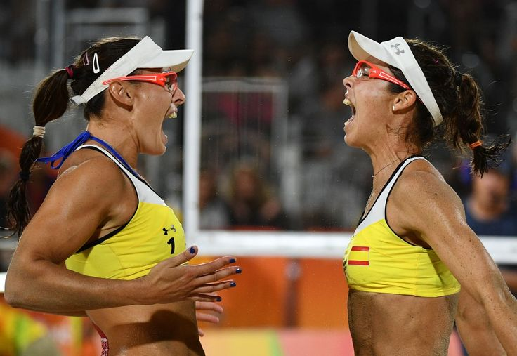 TOPSHOT - Spain's Liliana Fernandez Steiner (L) and Elsa Baquerizo McMillan celebrate after winning the women's beach volleyball qualifying match between Spain and the Czech Republic at the Beach Volley Arena in Rio de Janeiro on August 8, 2016, for the Rio 2016 Olympic Games. / AFP / Leon NEAL        (Photo credit should read LEON NEAL/AFP/Getty Images)