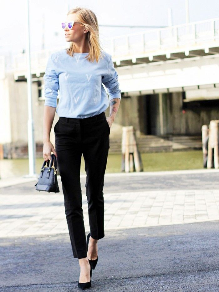 Tine Andrea of The Fashion Eaters accessorizes her simple blouse and trousers with a mini purse and mirrored sunglasses