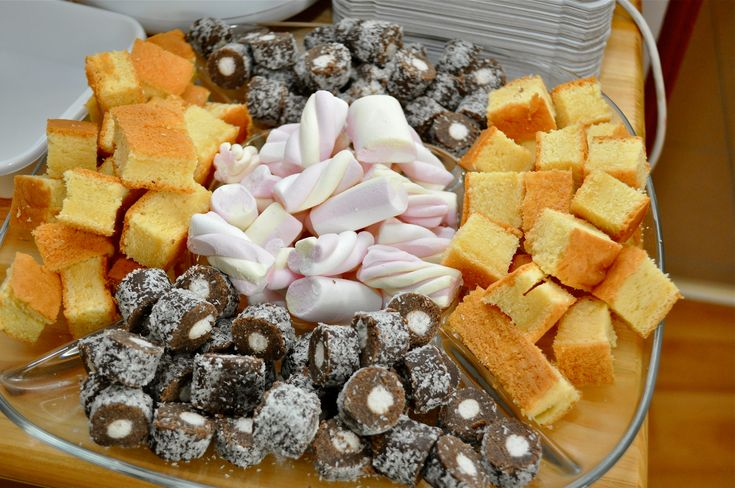 Dipping goodies for chocolate fountain: sponge-cake cubes, coconut-rolls, marshmallow (and fresh fruits: banana, grape, pineapple, apple, etc...)