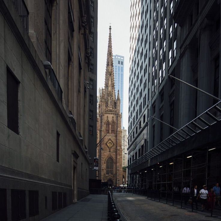 Trinity Church (1839-46)  - New York City - Located at the intersection of Wall Street & Broadwa. In 1696, the Anglicans petitioned the Royal Governor Benjamin Fletcher for a charter. The current structure is the 3rd structure & until 1869 was the tallest (281ft) building in the U.S. Burial place of Alexander Hamilton & the Espicopal Diocese of New York.