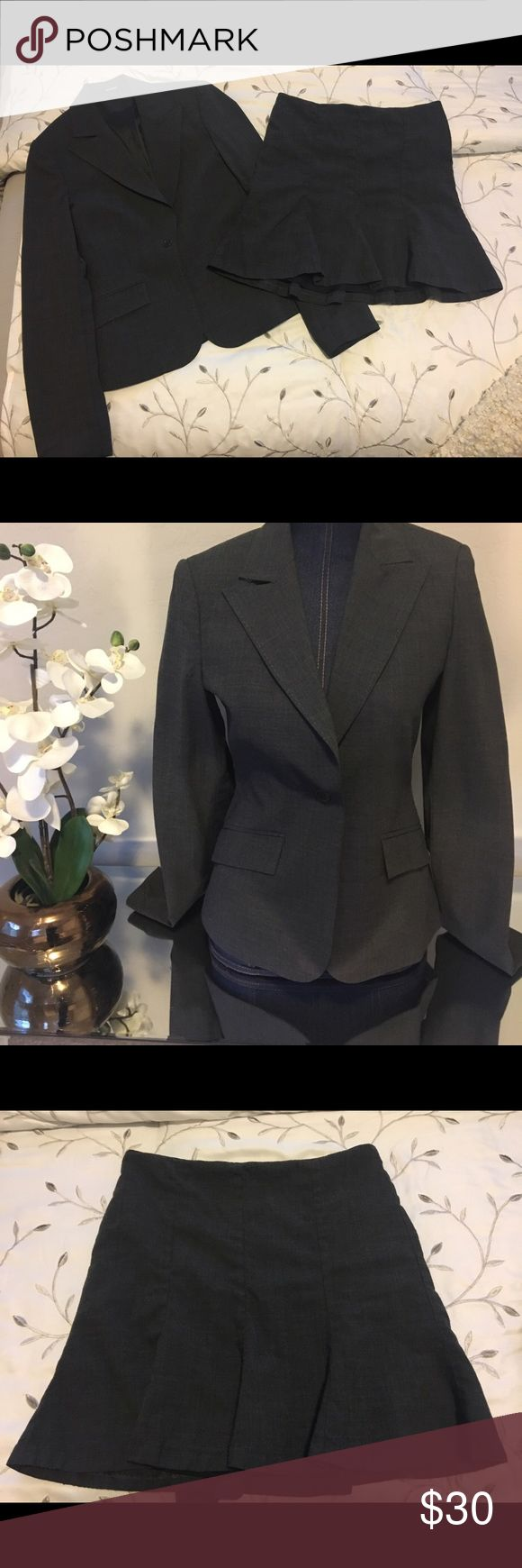 Size 4 jacket size 2 flirty squirt Reminds me of a school girl skirt yet office appropriate.dark gray. Cute for classy working girl! Express Other