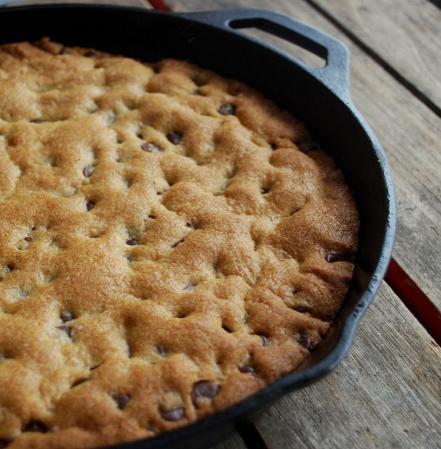 Giant Chocolate Chip Cookie Baked in a Cast Iron Pan 2 cups all purpose flour 1 teaspoon baking soda 1/2 teaspoon salt 3/4 cup (1 1/2 sticks) unsalted butter, softened  1/2 cup granulated sugar 3/4 cup packed light brown sugar 1 large egg 2 teaspoons of pure vanilla extract 1 1/2 cups chocolate chips (9 ounces)