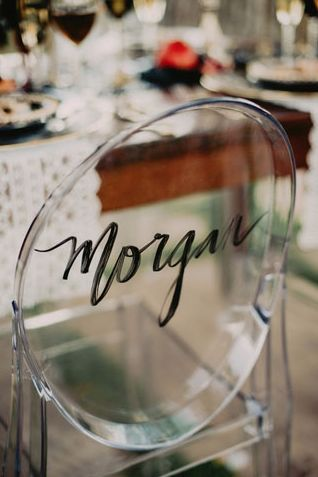 Love this idea with the calligraphy on the ghost chairs #wedding