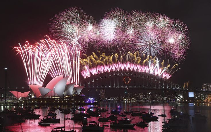 Fireworks explode over the Opera House and the Harbour Bridge during New Years Eve celebrations in Sydney