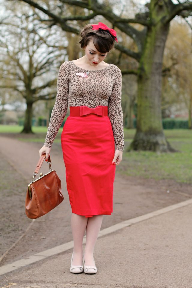 Red bow fascinator, leopard print top and red pencil skirt