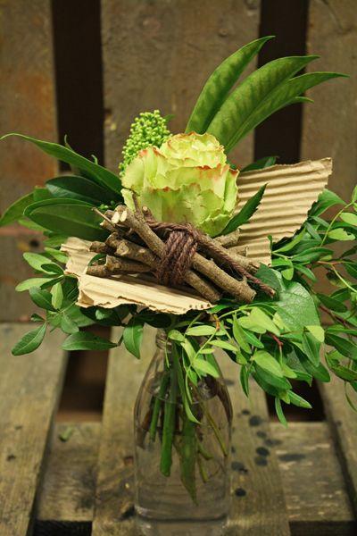 Vase arrangement with paper / cardboard accent - Zazu is the name of the fine rose | http://holmsundsblommor.blogspot.nl/2011_01_01_archive.html