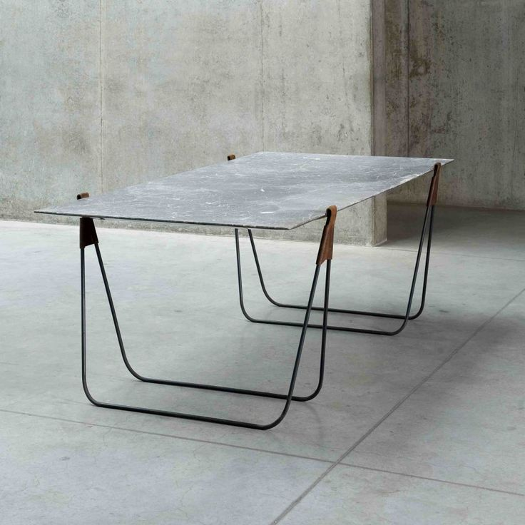 Ben Stormsu0027 Trestle Table Out Of Marble, Metal, And Leather Can Be  Transformed