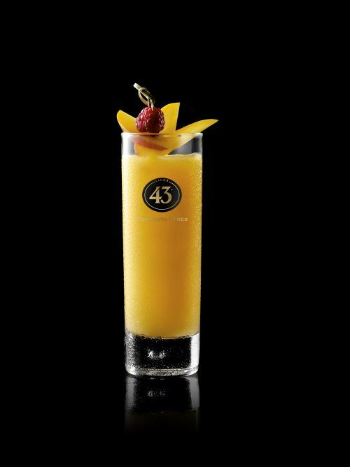 Mango Mambo     40 ml Licor 43 10ml Rum 15 ml fresh lemon juice Half a mango chopped  PREPARATION Mix all ingredients together with crushed ice in a blender or with a hand blender. Then pour the mixture into the glass. Garnish with small mango slices and a lemon curl.