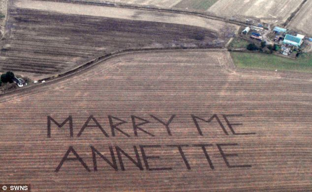 With a little help from his friends: Stuart Black got farmer school mate John Watt to carve the proposal into the field in 25-foot long letters...she said YES!!!!