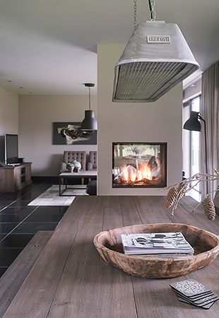 Two-sided fireplace | country interior | bluestone floor