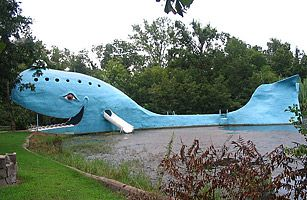 The Blue Whale - Catoosa, OK. Drive along Route 66 through a pair of side-by-side bridges and you're bound to come across an even more bizarre sight: a famous beached whale. Built in the 1970s as an anniversary gift from one man to his wife, Oklahoma's grinning Blue Whale is 80 feet long, and rests in a pond that has since become a favorite watering hole for locals and passing travelers.