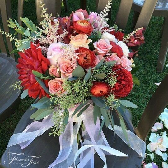 Red flowers mix bridal bouquet by Flowers Time