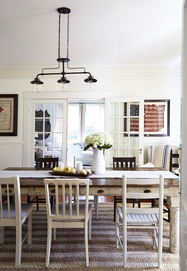 farm house table with mismatched chairs, framed vintage flag