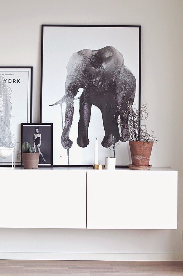 www.thewhitebox.no Scandinavian interior design. Painting by Stina Persson. Candle holders from Bolia and Bloomingville.